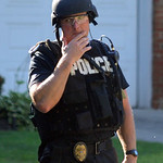 Special Response Team police leave Longfellow St. home on July 15.  Steve Manheim