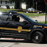 Lorain police cars on W. 44th and Ashland Ave during a suspect apprehension on July 24.  Steve Manheim