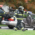 Sheffield Township Firefighters remove hazardous materials from the trunk of the car.
