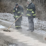 Sheffield Lake firefighters spread absorbent material on Mapleview Avenue in Sheffield Lake after somebody stole a 150-gallon fuel oil tank from a property that was set for demolition today.