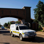 A forensics van leaves the housing estate where Olympian Oscar Pistorius lives, in Pretoria, South Africa, Thursday, Feb. 14, 2013. Reports say that a 30-year-old woman was shot dead at Pist …