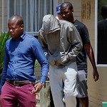 Olympic athlete Oscar Pistorius, center. leaves the Boschkop police station, east of Pretoria, South Africa, Thursday, Feb. 14, 2013 en route to appear in court charged with murder.  Olympic …