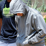 Olympic athlete Oscar Pistorius leaves the Boschkop police station, east of Pretoria, South Africa, Thursday, Feb. 14, 2013 en route to appear in court charged with murder.  Olympic athlete  …