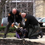 Outside the old Lorain County Courthouse, A Lorain County Sheriff's Deputy search a man who was reported to have a .380 handgun. It turned out to be a Playstation controller that was misiden …
