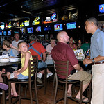 President Barack Obama talks with patrons of Ziggy's Pub and Restaurant in Amherst, Ohio, Thursday, July 5, 2012. Obama is on a two-day bus trip through Ohio and Pennsylvania. (AP Photo/Susa …