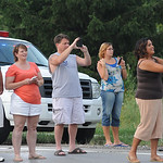 People take pictures of Obama motorcade on Leavitt Rd. July 5. Steve manheim