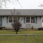 The duplex on state Route 303 where a man held police at bay for most of the day. SWAT team members later found him dead of a self-inflicted gunshot wound.