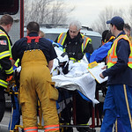 LifeCare and North Ridgeville firefighters move an accident victim to the Lifefligth helicopter on Rt. 83 in North Ridgeville after his car was clipped a semi-tractor trailer's rear tire on  …