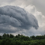 A large cloud leads the way as a second storm enters the area near Amherst after a smaller one blew through the area.