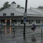 Jamie's Flea Market in Amherst closed as a storm blew in causing vendors and shoppers to run to their cars in order to stay dry on Wednesday afternoon, July 10. KRISTIN BAUER | CHRONICLE