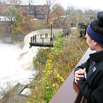 Nicole Edwards, of Elyria, looks the high water at East Falls at the East Falls Riverwalk on Oct. 30.  Steve Manheim