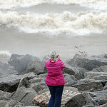 Aliesha Peterson, of Elyria, checks out the high waves at Lakeview Park in Lorain on Oct. 30.   Steve Manheim