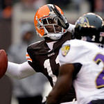Cleveland Browns wide receiver Mohamed Massaquoi passes for a 29-yard touchdown to wide receiver Brian Robiskie in the first quarter of an NFL football game against the Baltimore Ravens, Sun …