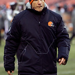 Cleveland Browns head coach Eric Mangini walks off the field after a 20-10 loss to the Baltimore Ravens in an NFL football game Sunday, Dec. 26, 2010, in Cleveland. (AP Photo/Tony Dejak)