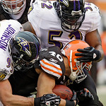 Baltimore Ravens linebackers Jarret Johnson, front left, and Ray Lewis (52) stop Cleveland Browns running back Peyton Hillis  (40)after a short gain in the fourth quarter of an NFL football  …