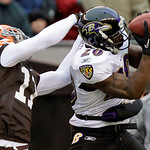 Baltimore Ravens cornerback Ed Reed (20) intercepts a pass intended for Cleveland Browns wide receiver Mohamed Massaquoi (11) in the second quarter of an NFL football game Sunday, Dec. 26, 2 …