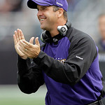 Baltimore Ravens coach John Harbaugh applauds after the Ravens scored against the Cleveland Browns during the first half of NFL football game, Sunday, Sept. 26, 2010, in Baltimore. The Raven …