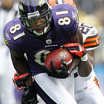 Baltimore Ravens wide receiver Anquan Boldin (81) is stopped by Cleveland Browns defensive back Mike Adams during the first half of an NFL football game in Baltimore, on Sunday, Sept. 26, 20 …
