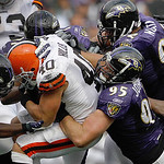 Cleveland Browns running back Peyton Hillis is stopped by Baltimore Ravens linebacker Terrell Suggs, linebacker Jarret Johnson, defensive tackle Haloti Ngata and linebacker Ray Lewis during …