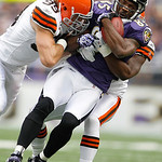 Baltimore Ravens wide receiver Derrick Mason is stopped by Cleveland Browns linebacker David Bowens, left, and Browns cornerback Sheldon Brown, right, during the first half of an NFL footbal …