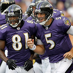 Baltimore Ravens wide receiver Anquan Boldin, left, and quarterback Joe Flacco run off the field after Boldin scored on a Flacco pass during the second half of an NFL football game in Baltim …