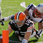 Cleveland Browns quarterback Colt McCoy (12) dives into the end zone in front of New England Patriots linebacker Tully Banta-Cain (95) on a 16-yard touchdown run in an NFL football game  Sun …