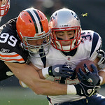 Cleveland Browns linebacker Scott Fujita (99) stops New England Patriots running back Danny Woodhead after a 6-yard run in the second quarter of abn in an NFL football game Sunday, Nov. 7, …