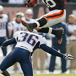 Cleveland Browns running back Peyton Hillis, top, leaps over New England Patriots safety Josh Barrett (36) on a first-quarter run in an NFL football game Sunday, Nov. 7, 2010, in Cleveland. …