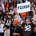 Fans celebrate the Cleveland Browns&#039; 34-14 win over the New England Patriots in an NFL football game  Sunday, Nov. 7, 2010, in Cleveland. (AP Photo/Tony Dejak)