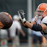 Cleveland Browns defensive end Brian Schaefering works with a medicine ball during the Browns NFL football training camp in Berea, Ohio on Wednesday, Aug. 4, 2010.  (AP Photo/Amy Sancetta)
