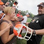 Cleveland Browns defensive coordinator Rob Ryan signs autographs for fans following the morning session of the Browns NFL football training camp in Berea, Ohio on Wednesday, Aug. 4, 2010.  ( …