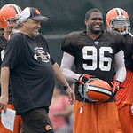 Cleveland Browns defensive coordinator Rob Ryan, front left, and linebacker David Bowens (96)  laugh during the Browns NFL football training camp in Berea, Ohio, on Wednesday, Aug. 4, 2010.  …