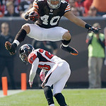 Cleveland Browns running back Peyton Hillis (40) leaps over Atlanta Falcons cornerback Brent Grimes (20) during the first quarter of an NFL football game Sunday, Oct. 10, 2010, in Cleveland. …