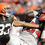 Atlanta Falcons linebacker Stephen Nicholas (54) catches an interception as Cleveland Browns wide receiver Chansi Stuckey tries to get the ball loose in the fourth quarter in an NFL football …