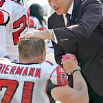 Atlanta Falcons defensive end Kroy Biermann (71) is congratulated by team majority owner Arthur Blank after scoring a touchdown on an interception of Cleveland Browns quarterback Jake Delhom …