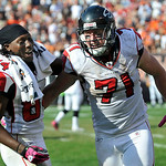 Atlanta Falcons defensive end Kroy Biermann (71) is congratulated by wide receiver Roddy White (84) after scoring a touchdown on an interception of Cleveland Browns quarterback Jake Delhomme …