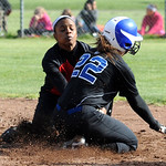 Brunswick's Briana Bentler is tagged out by Elyria's Sybil Roseboro on a steal attempt at second base in second inning on Apr. 11.   Steve Manheim