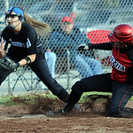 Elyria Haley Looney slides safe into third before the throw reaches Brunswick Nicole Hoy in third inning Apr. 11.  Steve Manheim