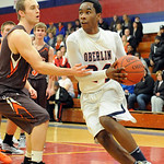 Oberlin Noland Isom drives to hoop past Buckeye Garrett Beck Jan. 22. Steve Manheim