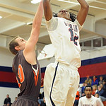 Oberlin Charles Lewis puts up shot over Buckeye Garrett Beck in first half Jan. 22. Steve Manheim