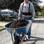 John Fath, left, of Gates Ave. in Elyria, moves mulch on Gates Ave. for Building Better Communities on Sep. 28.   Steve Manheim