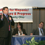 Terry Boose, left, and Mathew Lark , right, at the CHIP Debate at St. Joe&#039;s Community Center. The moderator, center, is Mary Santiago.