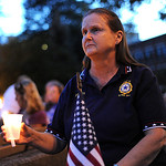 Shirley Gallaher, of Elyria, and the Elyria American Legion Post 12 Auxiliary, holds a candle at the 11th anniversary 9/11 Candlelight Service on Sep. 11, 2012.   Steve Manheim
