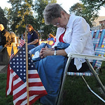Elsie Brewer of Elyria bows in prayer at the 11th anniversary of 9/11 Candlelight Service at Ely Square on Sep. 11, 2011.  Steve Manheim