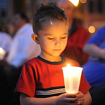 Ryley Machovina, 4, of Elyria, holds a candle at the 11th anniversary 9/11 Candlelight Service on Sep. 11, 2012.   Steve Manheim