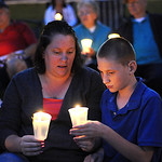 Lisa Tucker and her son Justin, 13, of Elyria, hold candles at the  11th anniversary 9/11 Candlelight Service at Ely Square on Sep. 11, 2012.   Steve Manheim