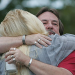 Ken Hoholski receives a hug of condolence from an attendee to a candlelight vigil for his daughter Catherine 'Kat' Hoholski who was found deceased in a Lorain storage unit.  photo by Chuck H …