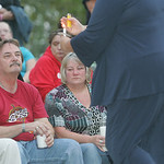 "Kat's dad Ken (in red) and mother Jane (sitting next to Ken) attend a heart-warming turnout for their daughter. The candlelight vigil was held to remember Catherine ""Kat' Hoholski at Veteran …"