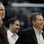 Michael Gearon, second from left, and Bruce Levenson, right, attend an NBA basketball game between the Atlanta Hawks and the Cleveland Cavaliers on Wednesday, Dec. 22, 2010, in Atlanta. The  …