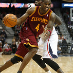 Cleveland Cavaliers forward Antawn Jamison (4) dribbles past Atlanta Hawks forward Marvin Williams during the fourth quarter of an NBA basketball game Wednesday, Dec. 22, 2010, in Atlanta. A …
